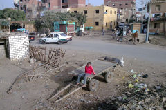 A child sits on a cart in Al Faiyum in Egypt