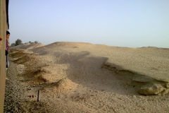 Desert at the edge of the railway line between Al Faiyum and Al Wasta in Egypt.