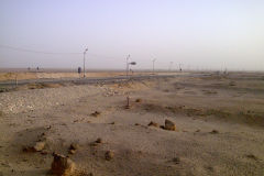 Desert landscape at the edge of the railway line between Al Faiyum and Al Wasta in Egypt.