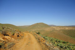Dirt  road on a hill near Legzira, Morocco