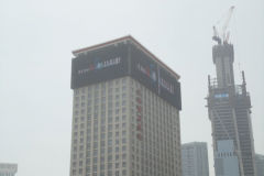 Screens on high-rise buidlings in the city centre of Dalian, China