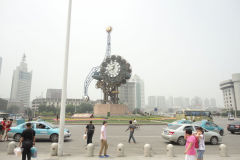 A strange clock in front of the train station in Tianjin, China