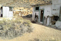 Old abandoned buildings at the Aguereberry Camp near Death Valley National Park, California, USA