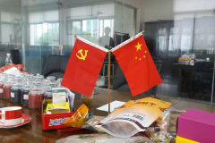 Chinese flag and communist party flag on a meeting table in Suzhou, China