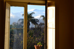 Mount Etna through the window of our house at new years eve in Sicily, Italy