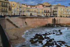 A very small beach in Syracuse on Ortygia, Sicily, Italy