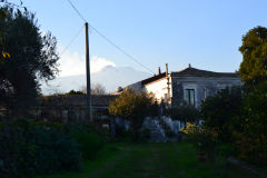 The smoking Mount Etna as seen from the garden of our house in Sicily, Italy