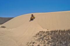 Quad driving at the coast of Coral Bay, Western Australia