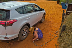 Inreasing air pressure for returning to the road at Shark Bay, Western Australia