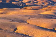 Desert landscape during sunset  at Valley of a Thousand Hills Campsite in Namibia