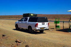 Car at a rest stop in the Kalahari Desert in Namibia
