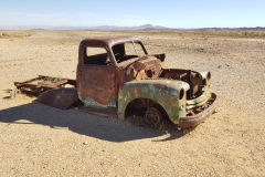 An old shooted car on the road to Ais-Ais in the Fish River Canyon Namibia